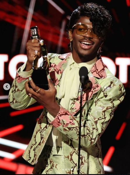Lil Nas X Steps up His Style With Curly Bangs and a Gucci Suit at Billboard Music Awards